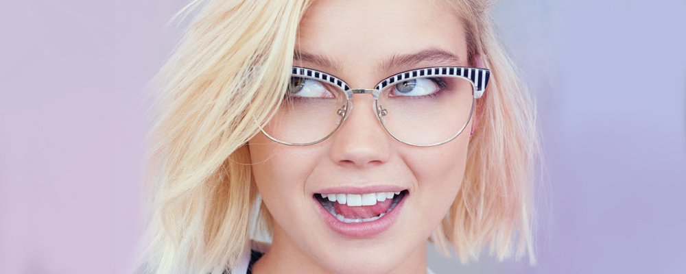 Woman wearing Betsey Johnson glasses frames